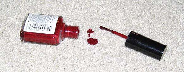 Spilt red nail varnish on cream carpet