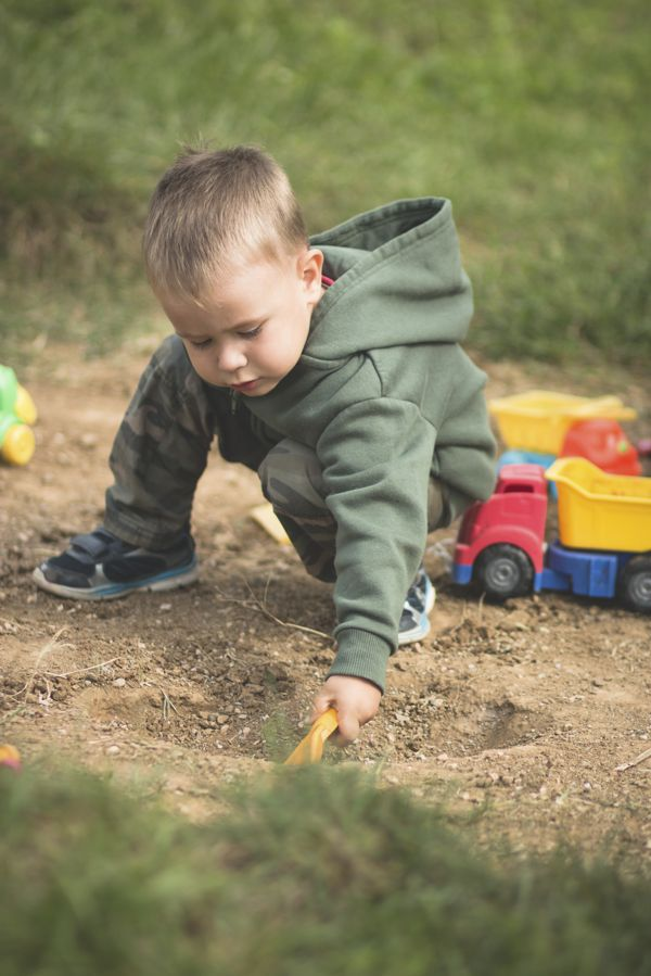 toddler playing in the dirt